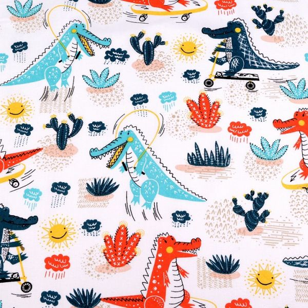 Bavlněná látka krémová - dinosaurus